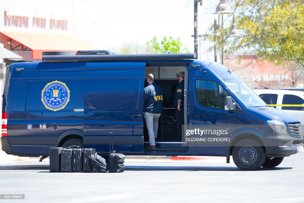 FBI Agents investigate at the Sunset Valley FedEx store located on Brodie Lane in Austin, Texas, which is linked to the package bomb which exploded on a conveyor belt in the sorting facility in Schertz, Texas on March 20, 2018. A package exploded at a FedEx distribution facility in Texas, news reports said, two days after the latest in a series of blasts in Austin attributed to a serial bomber. /