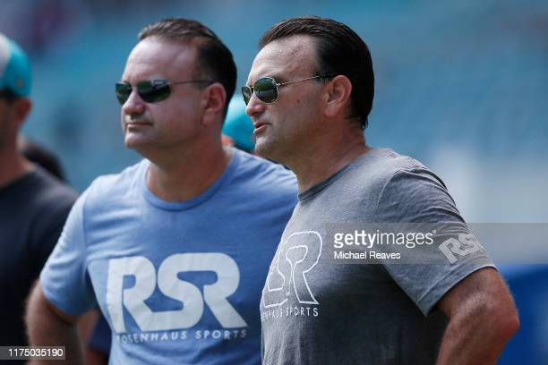 Agents Jason and Drew Rosenhaus look on prior to the game between the Miami Dolphins and the New England Patriots at Hard Rock Stadium on September...