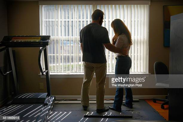 Agents Matt and Katia Litton at their apartment on October 2013 in Mclean, VA. They are trying to clear their names after being ensured in a legal...