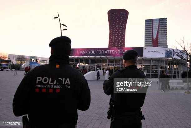 L´HOSPITALET CATALONIA SPAIN Agents of the Catalan Police Mossos d'Escuadra are seen standing on guard at the entrance of the Mobile World Congress...