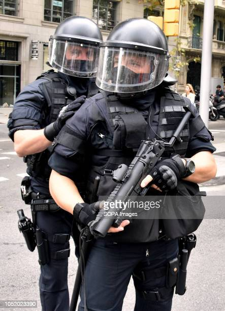 Agents of the riot police are seen on guard during an antifascist protest against 'Spanishism' in Barcelona during the celebration of the Hispanic Day