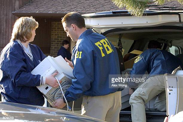 FBI agents remove evidence from the home of FBI agent Robert Philip Hanssen February 20 2001 in Vienna Va Veteran FBI agent Robert Philip Hanssen has...