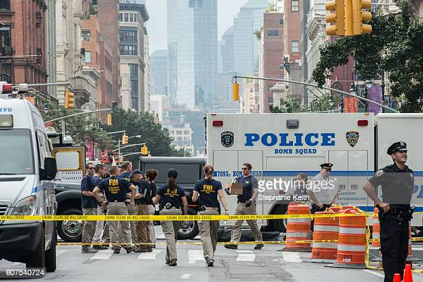 FBI agents review the crime scene of remnants of bomb debris on 23rd St in Manhattan's Chelsea neighborhood on September 18 2016 in New York City An...