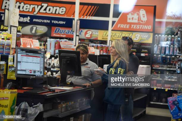 FBI agents search for clues and evidences at the Auto Zone Store in Plantation North of Miami on October 26 2018 where a suspect was arrested in...