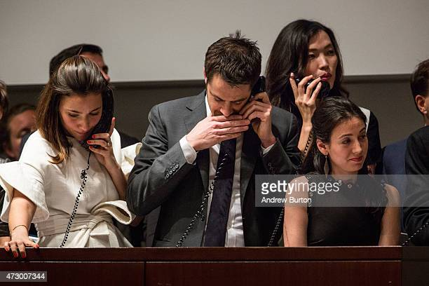 Agents speak on their phones with their clients while bidding on the art work 'Les femmes d'Alger ' painted by Pablo Picasso at Christie's on May 11...