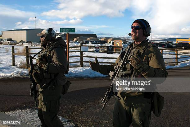 FBI agents stand guard outside the command headquarters at Burns Municipal Airport in Burns Oregon January 30 2016 in Burns Oregon Eight protestors...