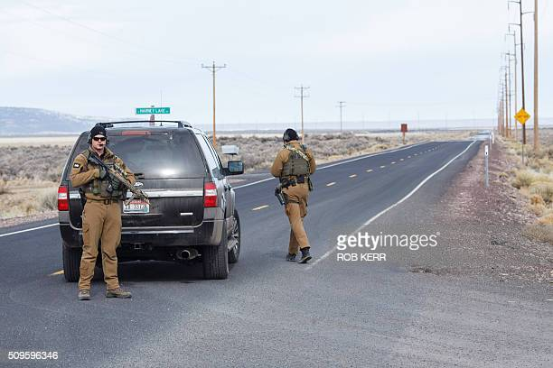 FBI agents temporarily close a stretch of road near the Malheur Wildlife Refuge Headquarters near Burns Oregon on February 11 2016 The FBI surrounded...