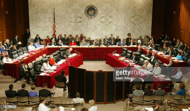 Agents testify behind a protective screen during a joint congressional House and Senate Intelligence Committee hearing on Capitol Hill September 24,...