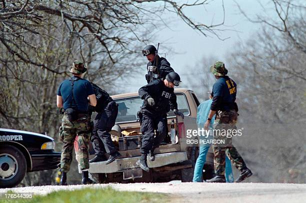 Agents unload from a pickup truck on March 12, 1993 near the Branch Davidian religious compound. After a shootout in Waco in 1993 that killed four...