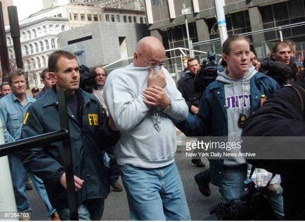 FBI agents walk alleged members of the Gambino organized crime family out from the New York Field Office at 26 Federal Plaza after the arrests of...