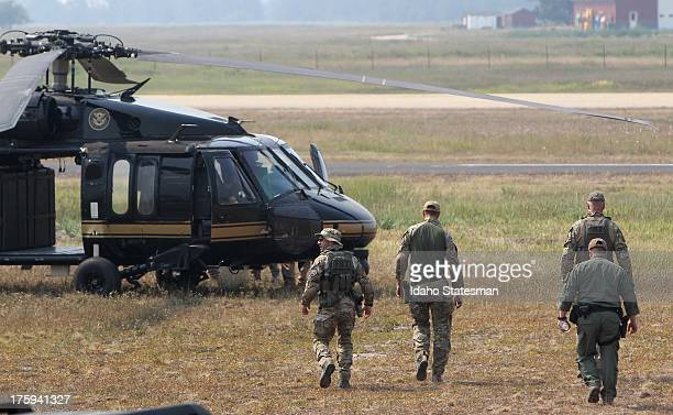 FBI agents walk toward a Blackhawk helicopter at the Cascade Airport in Cascade Idaho during the search for James DiMaggio in the Idaho backcountry...