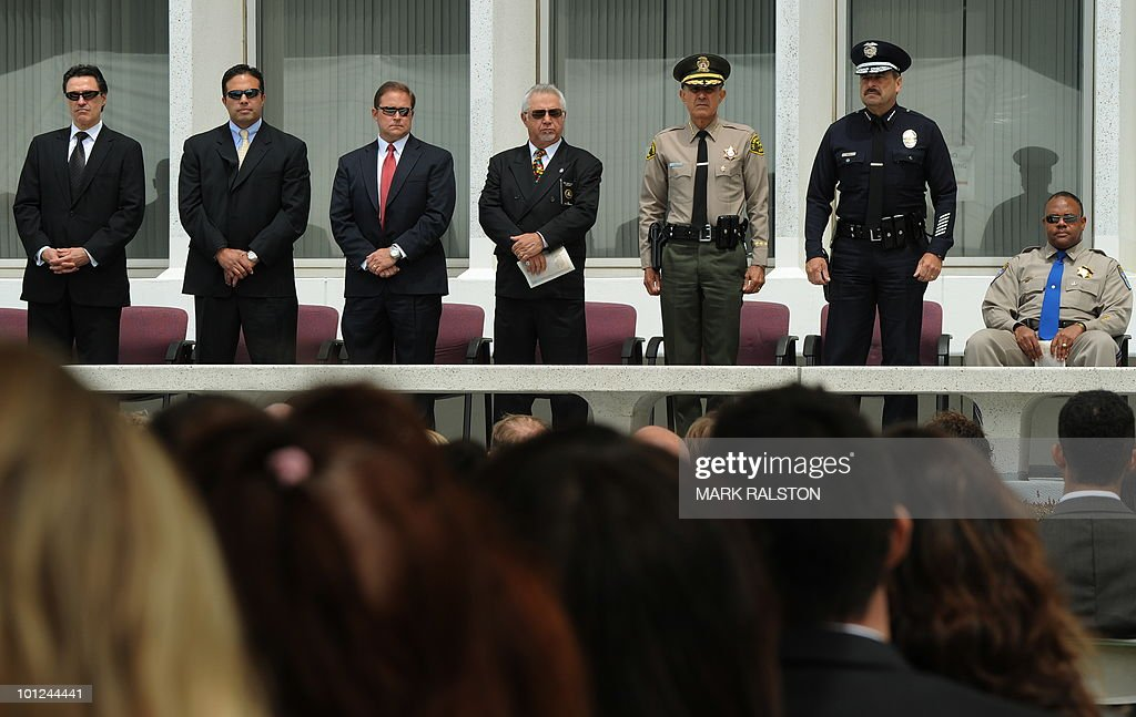 FBI agents with LA Sheriff Lee Baca (3rd R) LAPD Chief Charlie Beck (2nd R) during a memorial service for Special Agents and their law enforcement and military colleagues killed in the line of duty, at the Federal Building in Los Angeles on May 28, 2010. Memorial Day, which was formerly known as Decoration Day, commemorates U.S. men and women who died while in the service to their country and was first enacted to honor Union soldiers of the American Civil War. AFP PHOTO/Mark RALSTON