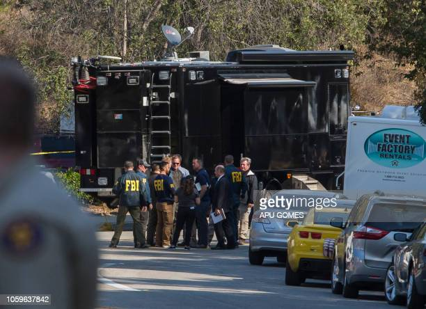 Agents work at the Borderline Bar and Grill's parking lot in Thousand Oaks, California on November 9, 2018. - Ian David Long, 28-year-old Marine...