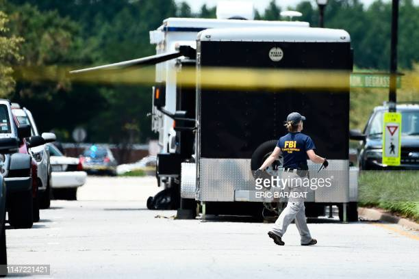 FBI agents work near building number 2 at the Virginia Beach Municipal Center the scene of the mass shooting in Virginia Beach Virginia on June 1...