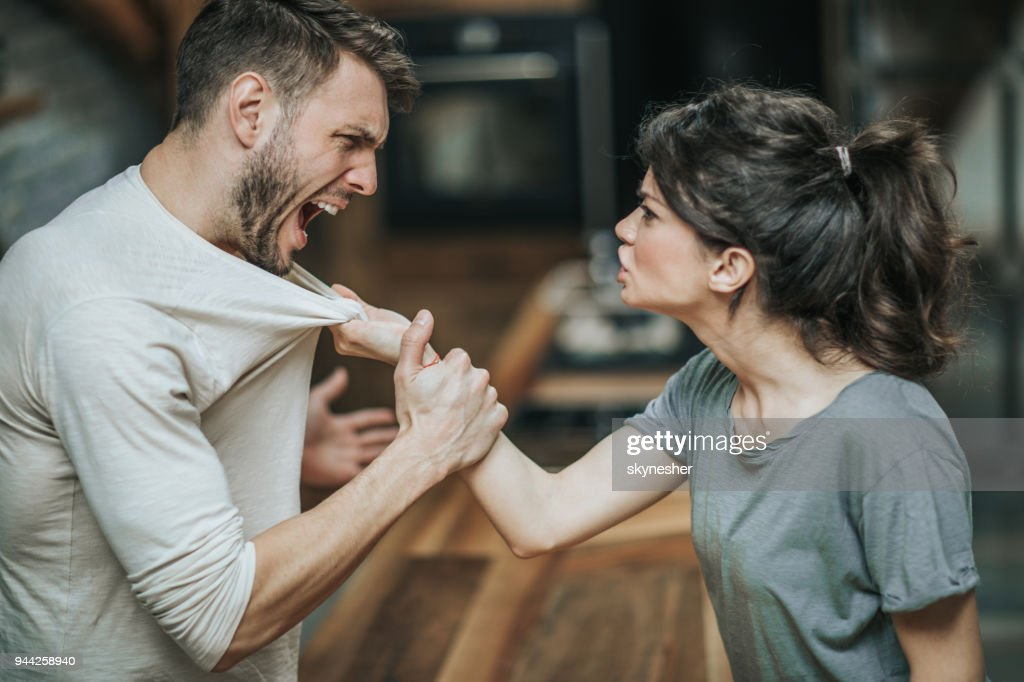 Aggressive couple arguing about their problems at home. : Stock Photo