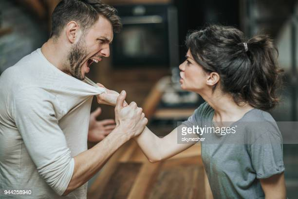aggressive couple arguing about their problems at home. - fury stock pictures, royalty-free photos & images
