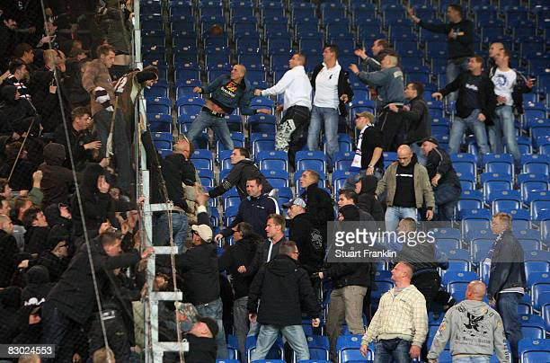 Aggressive fans of Rostock fight and throw objects at St Pauli fans after the Second Bundesliga match between FC Hansa Rostock and FC St Pauli at the...