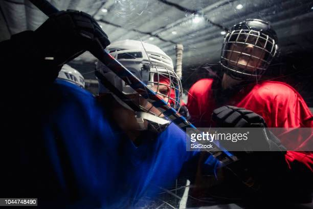 aggressive ice hockey players - tackling stock pictures, royalty-free photos & images