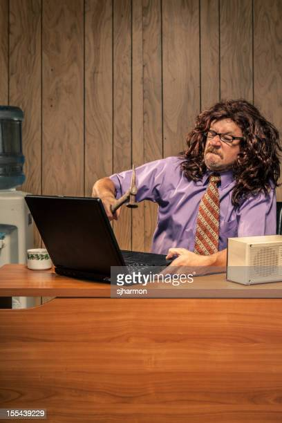 Aggressive Retro Office Worker Smashing his Computer with Hammer