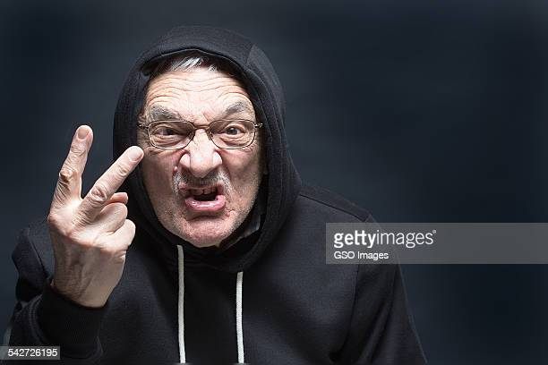 aggressive senior gives 2 finger salutre - obscene gesture stock photos and pictures