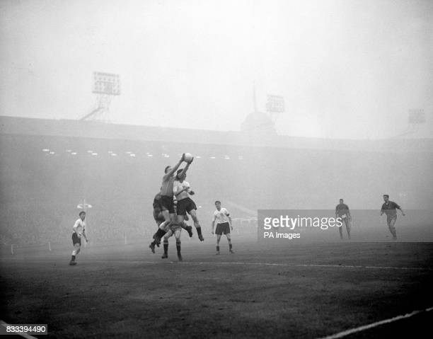 Agile England goalkeeper Ron Baynham leaps to snatch the ball after a Spanish corner kick