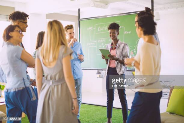 Agile team members brief on daily meeting