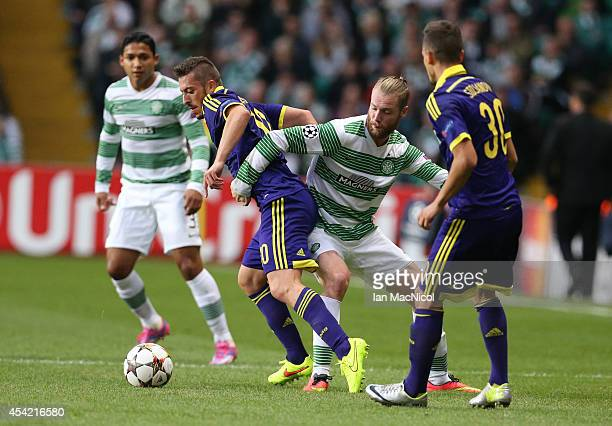 Agim Ibraimi of NK Maribor vies with Jo Inge Berget of Celtic during the UEFA Champions League Qualifying PlayOffs Round Second Leg Match between...