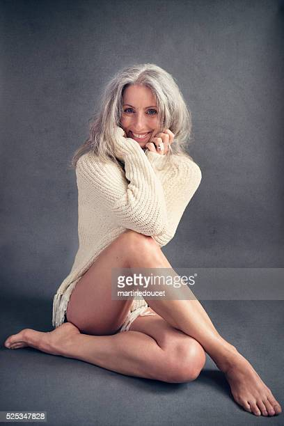 aging gracefully, beautiful mature woman with silver hair. - dressed undressed women stock pictures, royalty-free photos & images