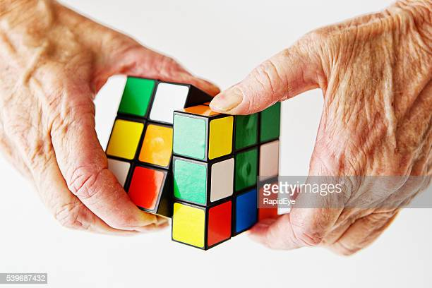 Aging, mental health, Rubiks Cube, problem solving, hands, puzzle, manipulating,
