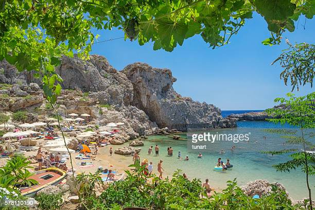 agios pavlos beach, lindos, rhodes, greece - lindos stock photos and pictures