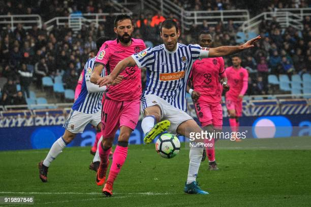 Agirretxe of Real Sociedad duels for the ball with Morales of Levante during the Spanish league football match between Real Sociedad and Levante at...