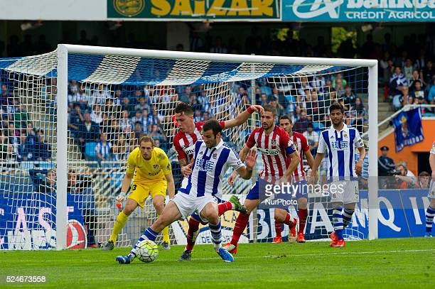 Agirretxe of Real Sociedad duels for the ball with Oblak Godin and Gabi of Atletico Madrid during the Spanish league football match between Real...