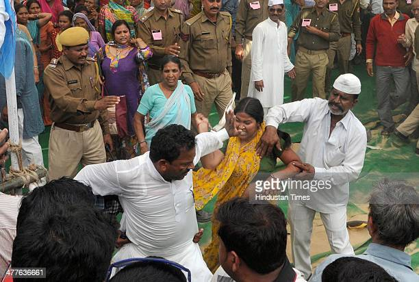 Agitated by mistreatment by men who entered women wing a woman started beating them with sticks while the cops looked on during the election rally of...