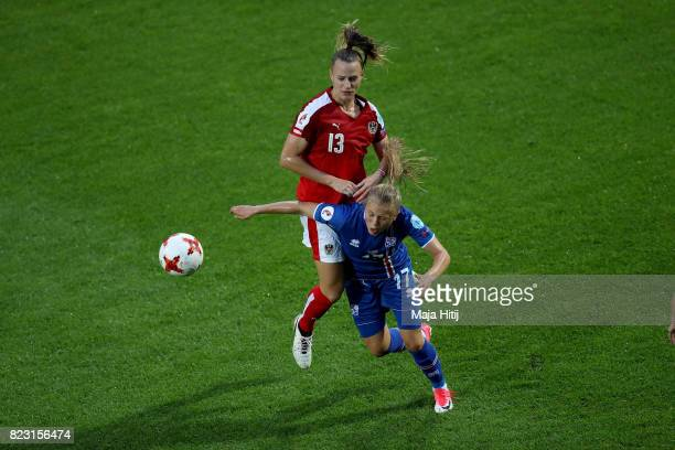 Agla Maria Albertsdottir of Iceland and Virginia Kirchberger of Austria compete for the ball during the Group C match between Iceland and Austria...