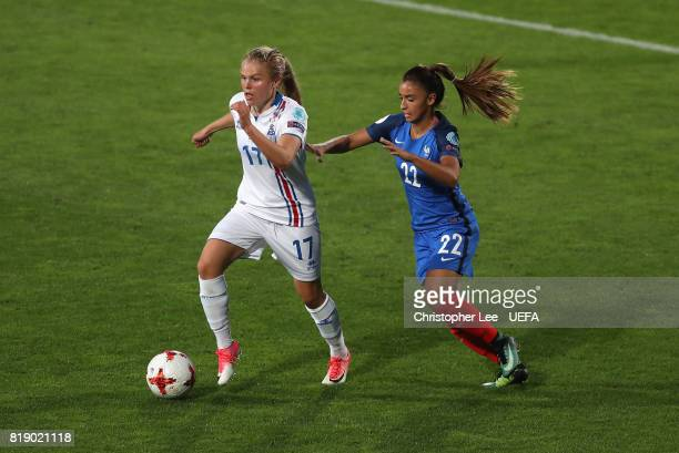 Agla Maria Albertsdottir of Iceland gets away from Sakina Karchaoui of France during the UEFA Women's Euro 2017 Group C match between France and...