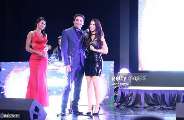 Agmeth Escaf and Jessica Cediel receive award at Premios Estrellas Digitales 2018 at James L Knight Center on May 31 2018 in Miami Florida