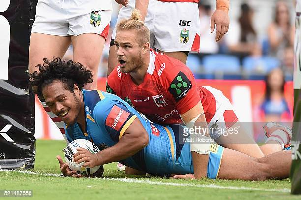Agnatius Paasi of the Titans scores a try during the round seven NRL match between the Gold Coast Titans and the St George Illawarra Dragons at Cbus...