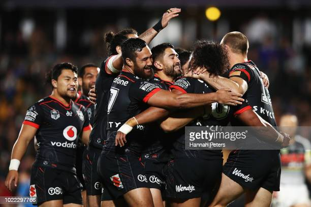 Agnatius Paasi of the Warriors celebrates after scoring a try during the round 24 NRL match between the New Zealand Warriors and the Penrith Panthers...