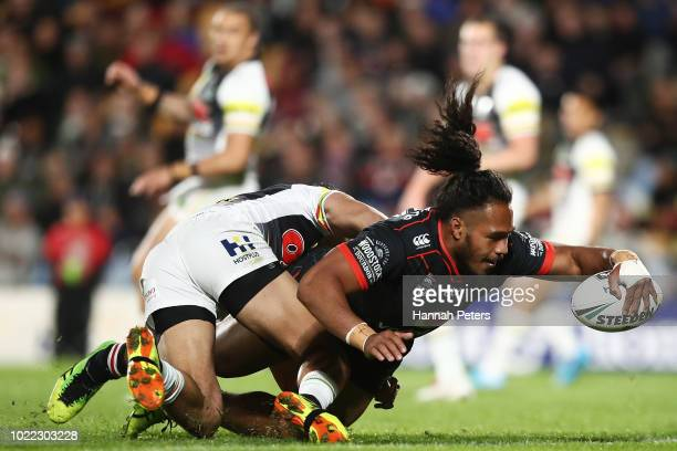 Agnatius Paasi of the Warriors dives over to score a try during the round 24 NRL match between the New Zealand Warriors and the Penrith Panthers at...