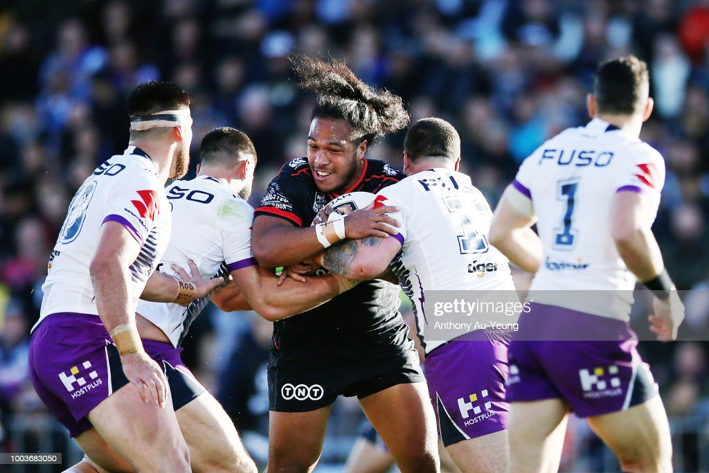 Agnatius Paasi of the Warriors is tackled during the round 19 NRL match between the New Zealand Warriors and the Melbourne Storm at Mt Smart Stadium on July 22, 2018 in Auckland, New Zealand.