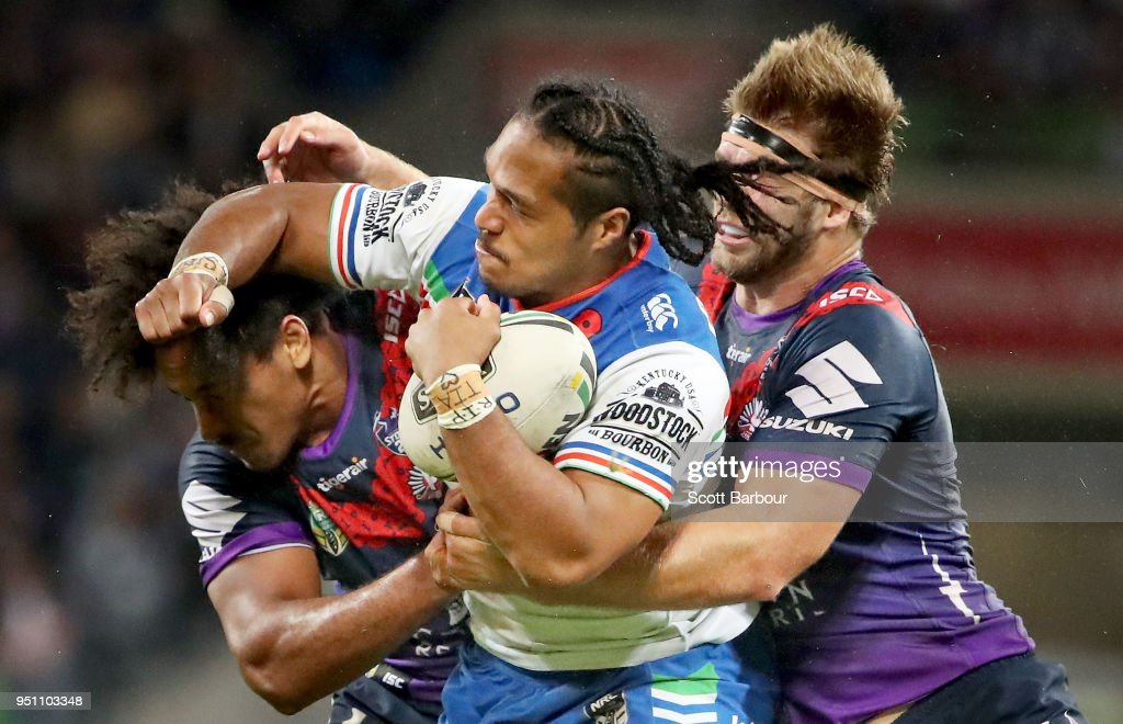 Agnatius Paasi of the Warriors is tackled during the round eight NRL match between the Melbourne Storm and New Zealand Warriors at AAMI Park on April 25, 2018 in Melbourne, Australia.