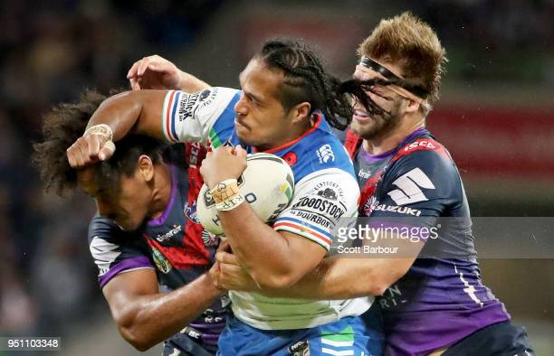 Agnatius Paasi of the Warriors is tackled during the round eight NRL match between the Melbourne Storm and New Zealand Warriors at AAMI Park on April...