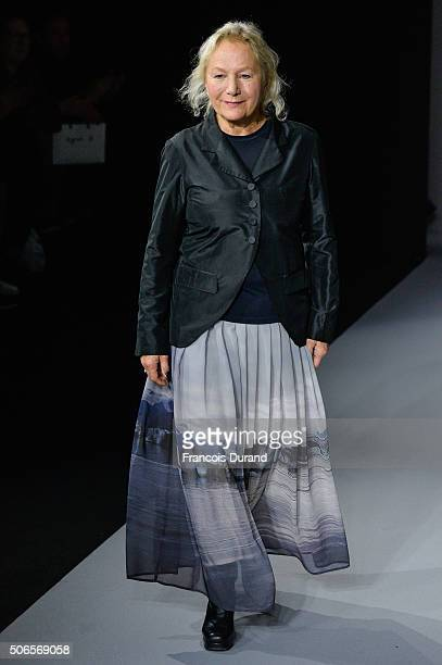 Agnes B acknoledges the applause of the public after the Agnes B Menswear Fall/Winter 20162017 show as part of Paris Fashion Week on January 24 2016...