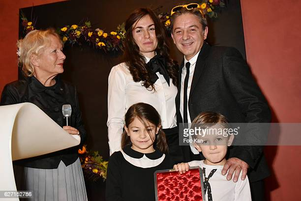 Agnes B, Aurele LostDog , his wife Illona Ricard and kids attend Sculptor painter Aurele LostDog receives the medal of Chevalier Des arts Et Lettres...