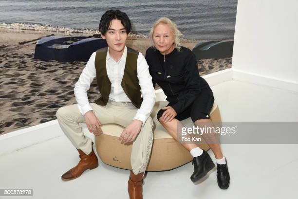 Agnes Band chinese actor Ruichang Wang pose during Agnes B Menswear Spring/Summer 2018 show as part of Paris Fashion Week ton June 25 2017 in Paris...