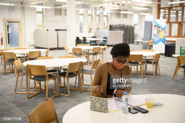 Agnes Cheba Ade, an International Economics student and former Miss Equatorial New Guinea, poses for photograph in Coventry University Library at the...