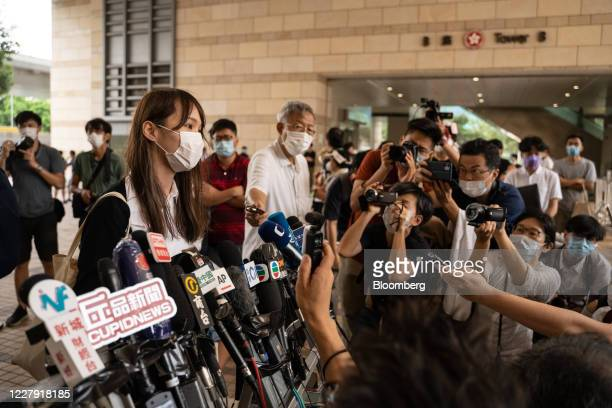 Agnes Chow, activist and former member of pro-democracy party Demosisto, left, speaks with members of the media outside the West Kowloon Law Courts...