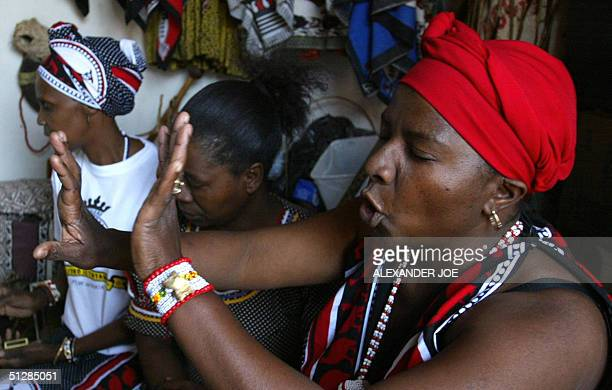 Agnes Gaobepe a sangoma working in Wattville a township of Benoni a small town located about one hour from Johannesburg gestures 09 September 2004...