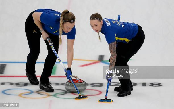 Agnes Knochenhauer and Sofia Mabergs of Sweden during the women's curling semifinal game between Sweden and Great Britain on day fourteen of the 2018...