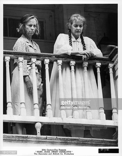Agnes Moorehead and Bette Davis looking over the rail in a scene from the film 'HushHush Sweet Charlotte' 1964